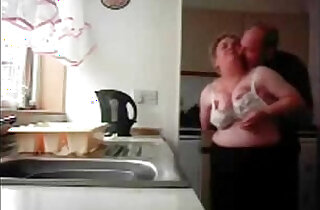 Mum and dad home alones having fun in the kitchen. Hidden cam